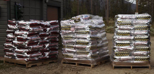 6,000 pounds of dog food, ready to be stacked in the garage.
